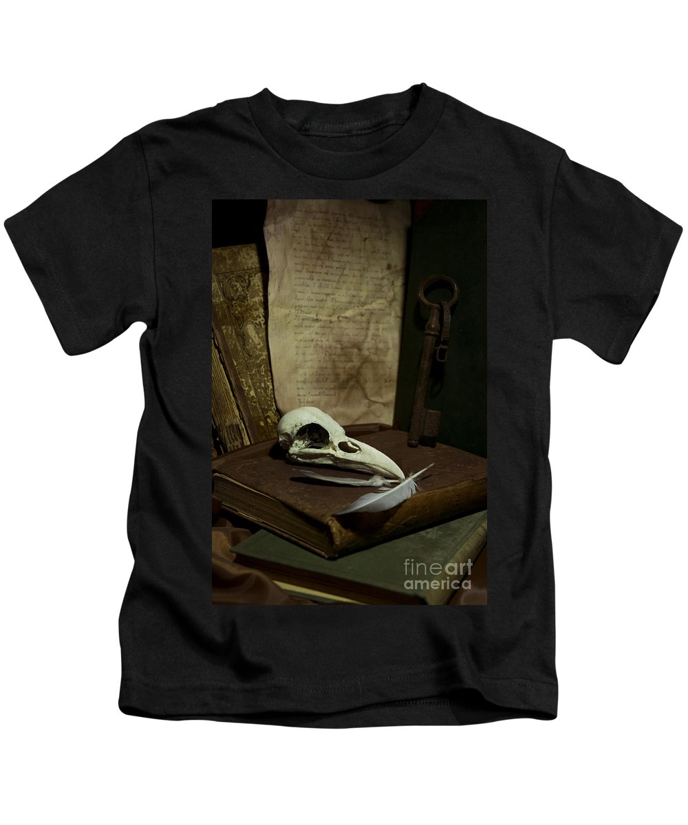 Still Life Kids T-Shirt featuring the photograph Still Life With Old Books Rusty Key Bird Skull And Feathers by Jaroslaw Blaminsky