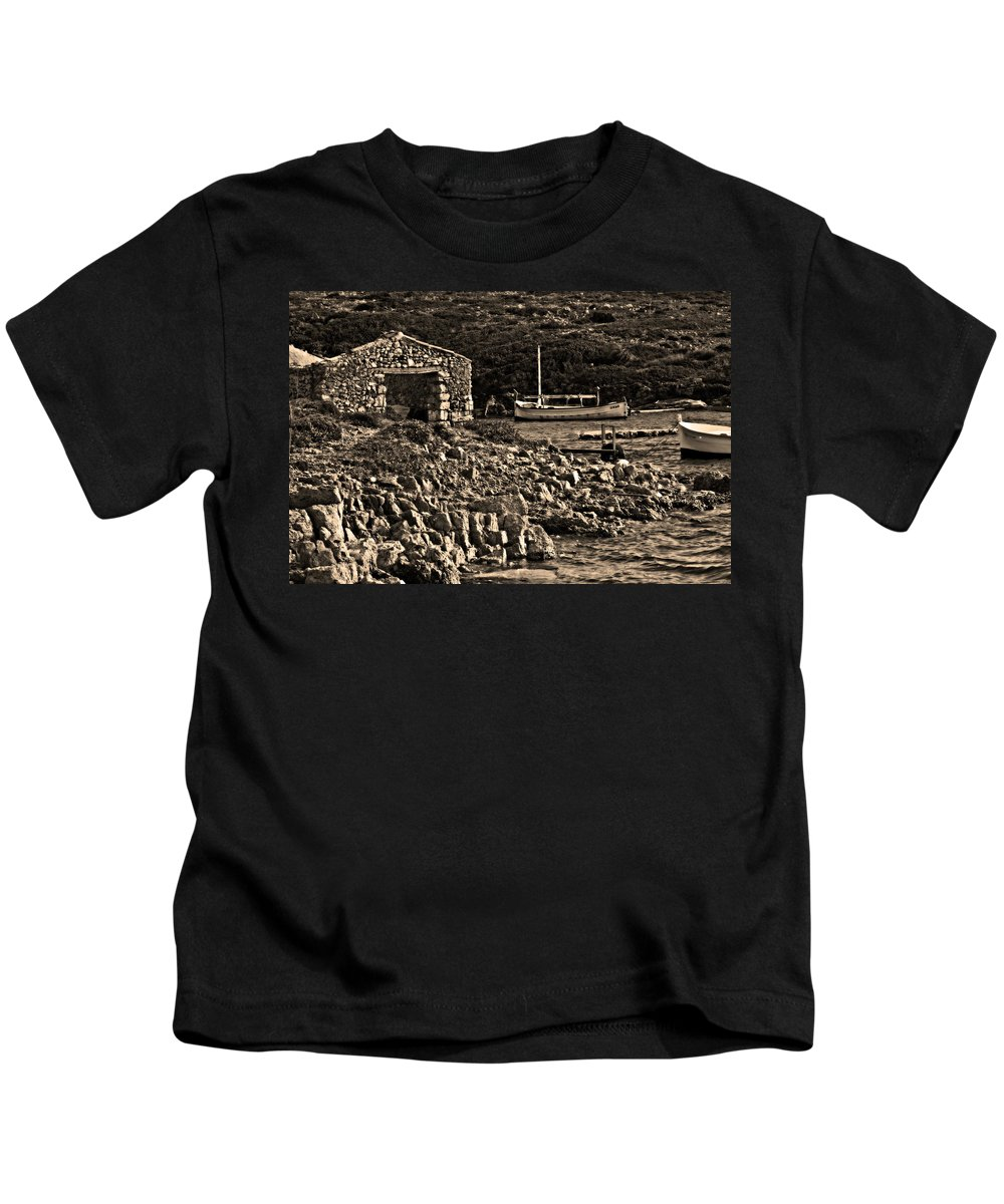 Beauty Kids T-Shirt featuring the photograph Roman Port Of Sa Nitja In Minorca - Stone And Sea Sephia Version by Pedro Cardona Llambias