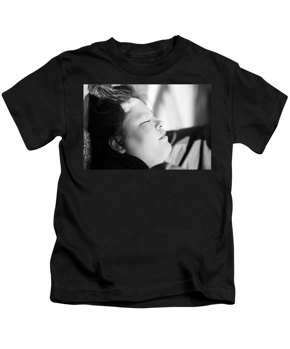 Street Photography Kids T-Shirt featuring the photograph Street Sleep by The Artist Project