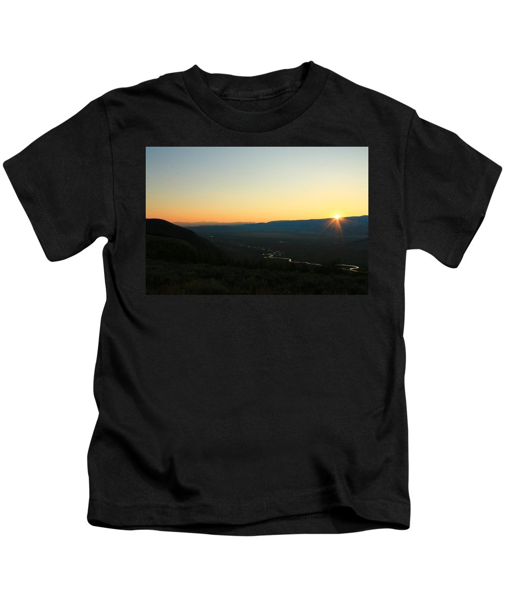 Jackson Hole Kids T-Shirt featuring the photograph Sun Peeking Over The Mountains by Catie Canetti