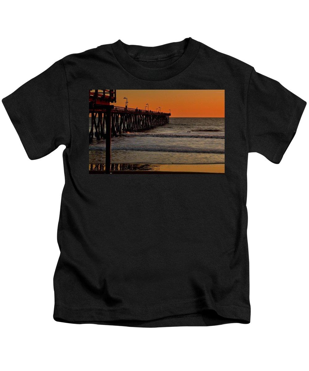 Port Hueneme Kids T-Shirt featuring the photograph Sundown Surfing by Michael Gordon