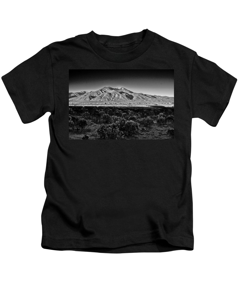 Taos Kids T-Shirt featuring the photograph Taos In Black And White X by Charles Muhle