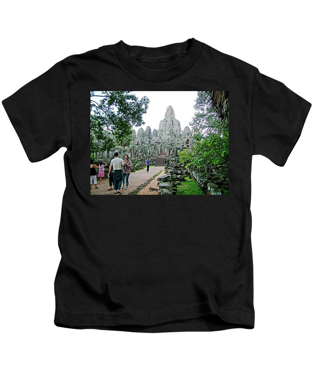 The Bayon In Angkor Thom In Angkor Wat Archeological Park Near Siem Reap Kids T-Shirt featuring the photograph The Bayon In Angkor Thom In Angkor Wat Archeological Park-cambodia by Ruth Hager