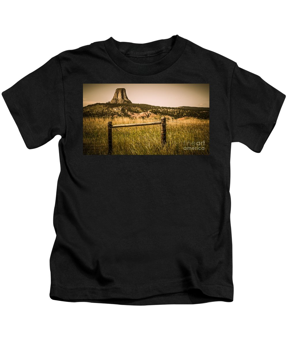 Devils Tower Kids T-Shirt featuring the photograph The Devils Tower by Perry Webster