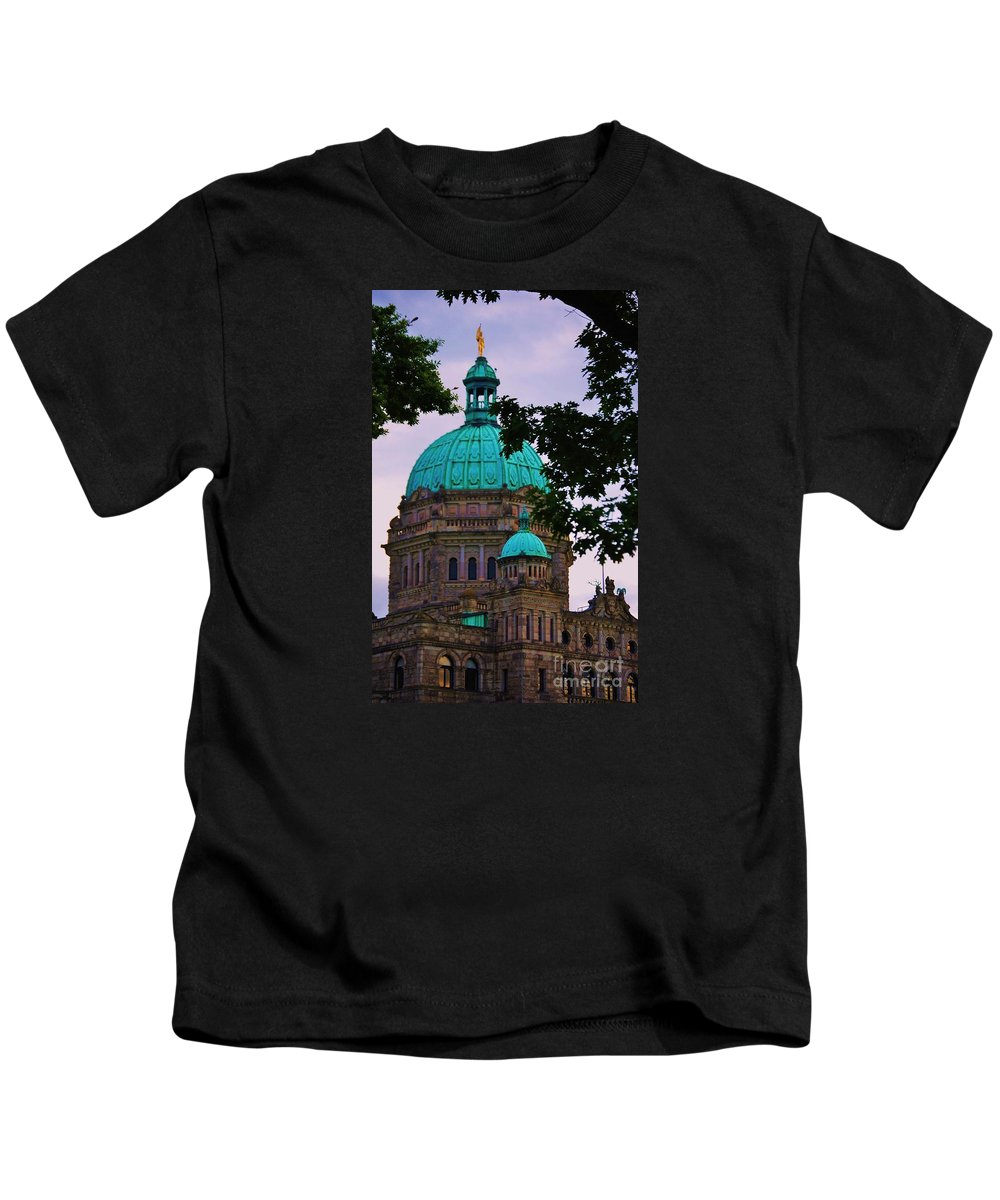 Architectural Art Windows Victoria British Columbia Canada Iconic Building Parliament Copper Domed Roof Victorian Architecture Framed By Trees Golden Statue Seat Of Government Vertical Vision Canvas Print Wood Print Poster Print Metal Frame Available On Greeting Cards Tote Bags Spiral Notebooks T Shirts Phone Cases And Mugs Kids T-Shirt featuring the photograph An Aspect Of The Legislative Building, Victoria, British Columbia by Marcus Dagan