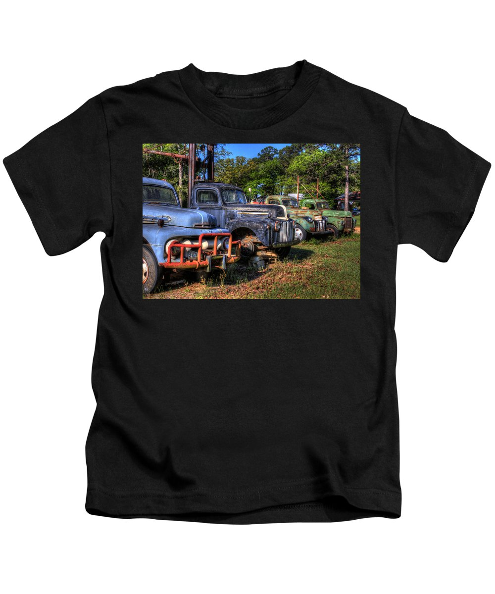 Antique Trucks Kids T-Shirt featuring the photograph The Lineup by Danny Pickens