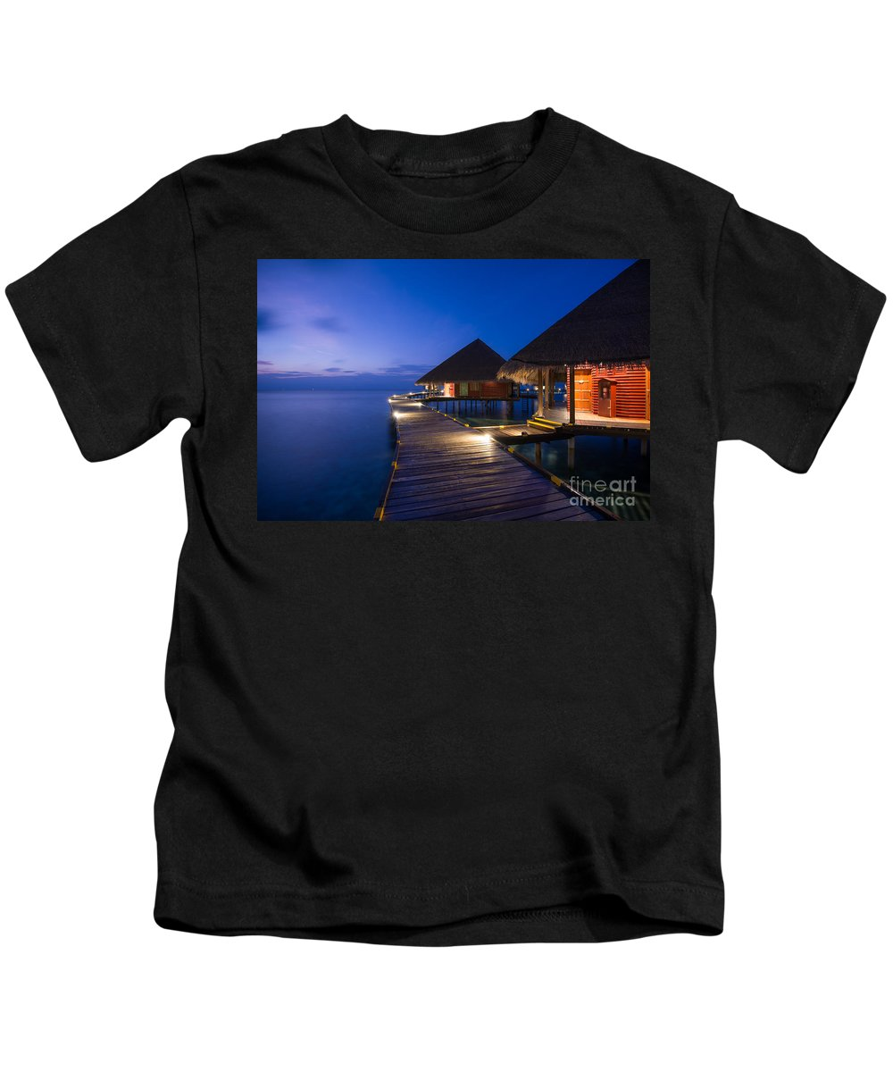 Maldives Kids T-Shirt featuring the photograph The Night Awakes by Hannes Cmarits