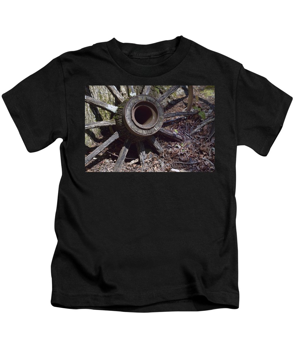 Antique Kids T-Shirt featuring the photograph Time Worn Antique Wagon Wheel by Kathy Clark