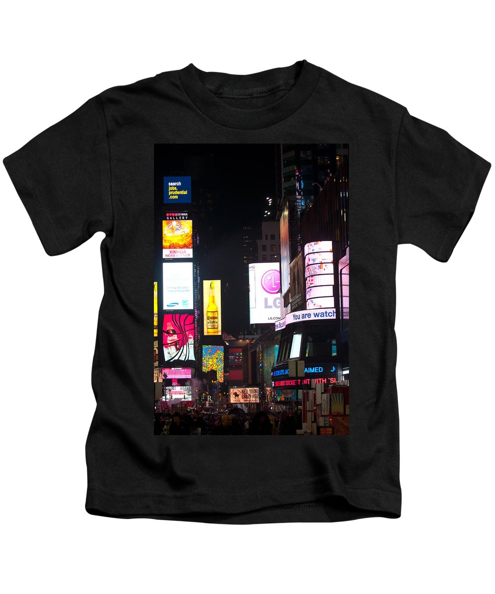 """new York City"" Kids T-Shirt featuring the photograph Towering Ads by Paul Mangold"
