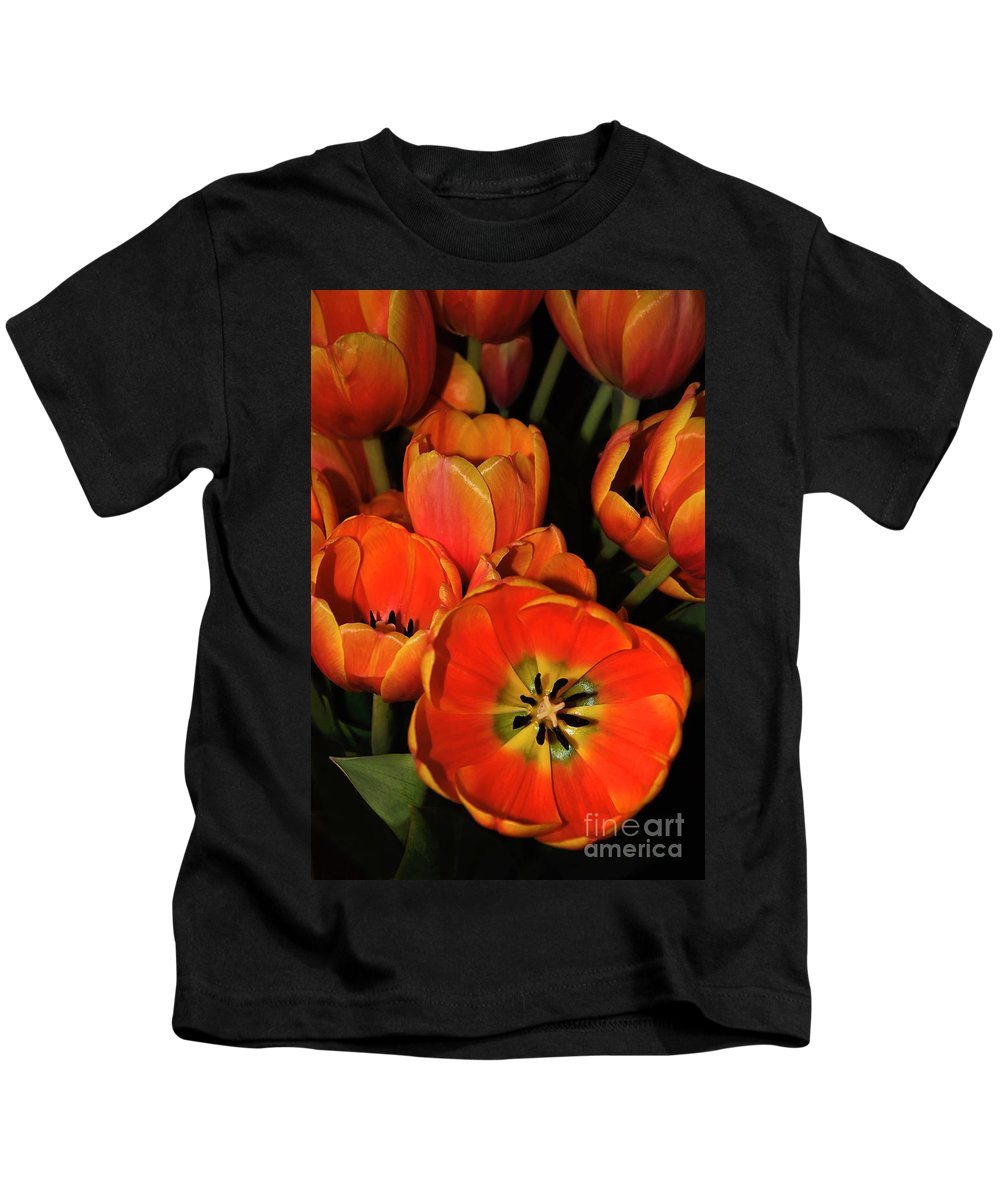Photography Kids T-Shirt featuring the photograph Tulips Of Fire by Kaye Menner