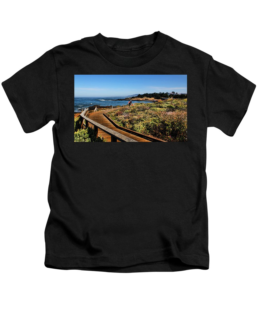 Moonstone Beach Kids T-Shirt featuring the photograph Walking On The Boardwalk by Judy Vincent