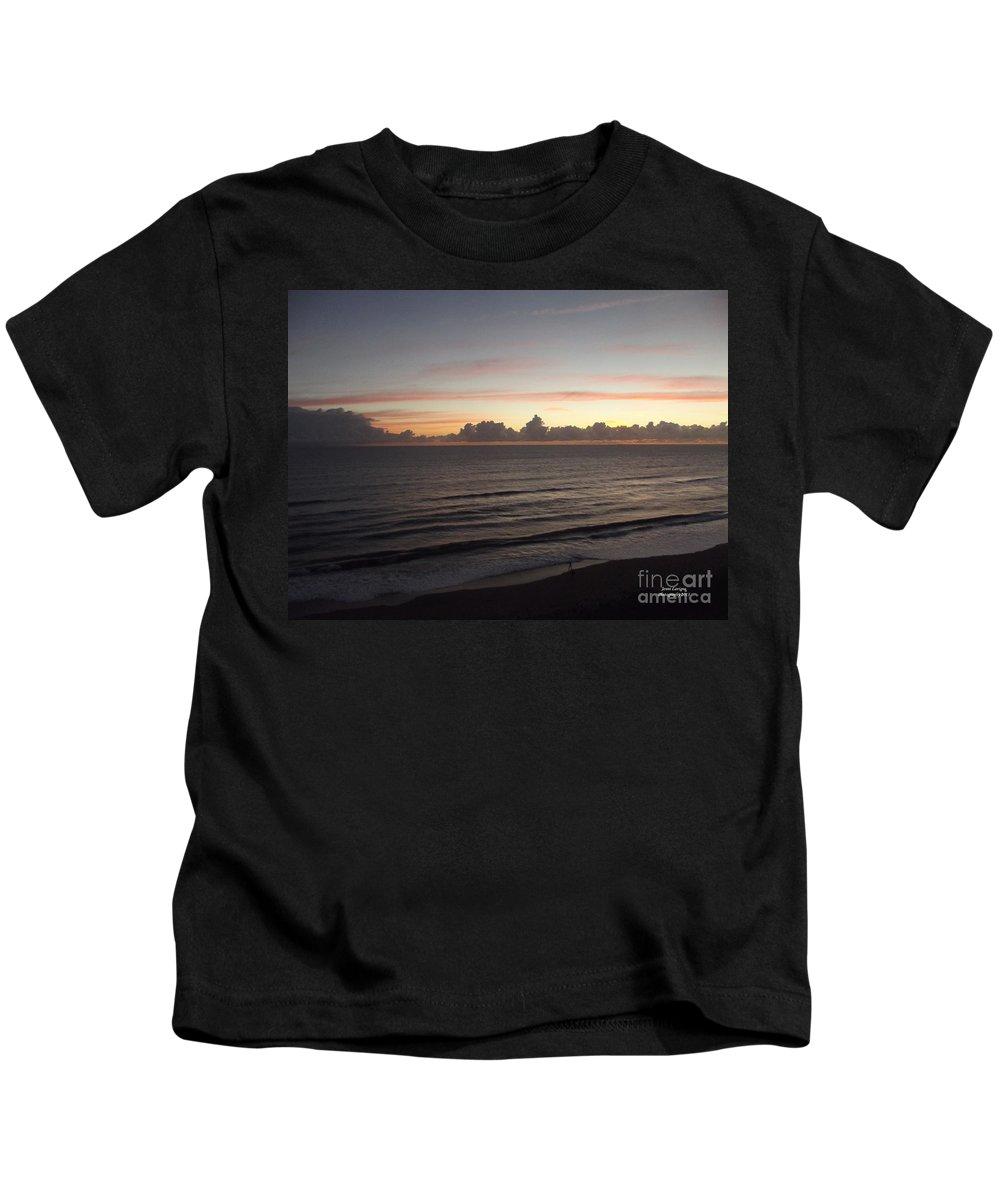 Sunrise Kids T-Shirt featuring the photograph Walking The Beach At Sunrise by Jennifer Lavigne