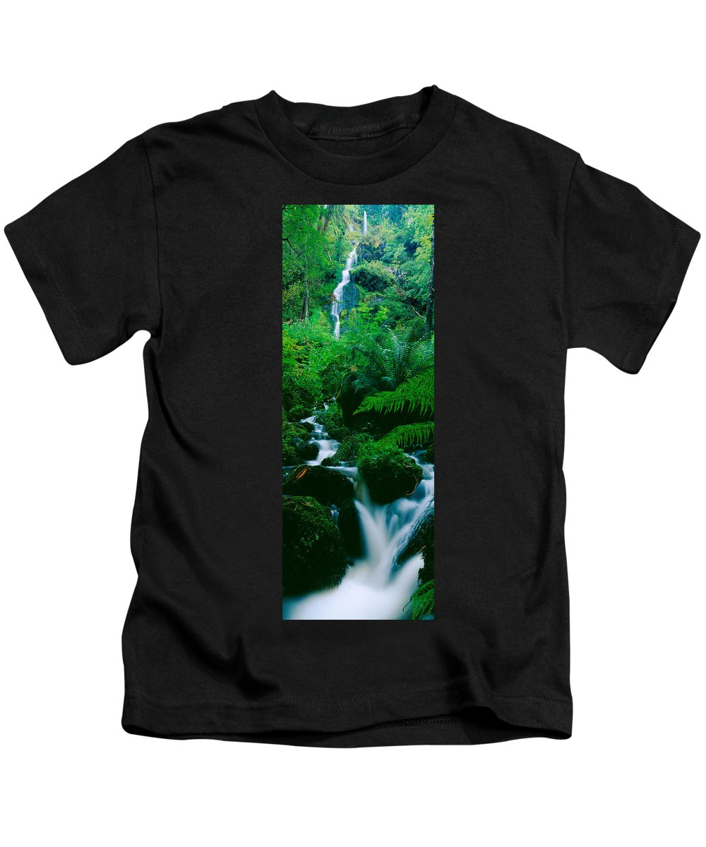 Photography Kids T-Shirt featuring the photograph Waterfall In A Forest, Dartmoor, Devon by Panoramic Images