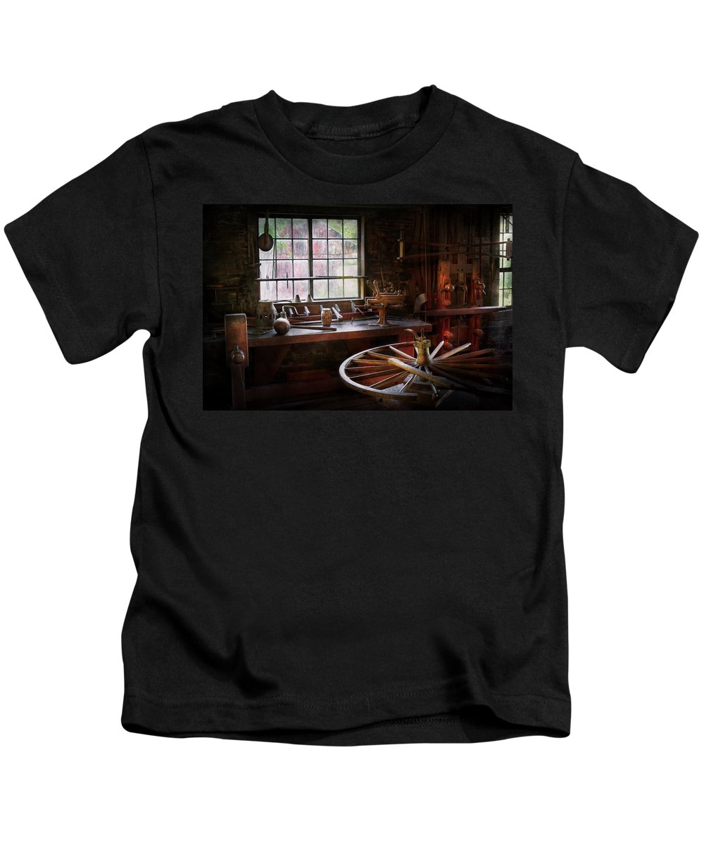 Carpenter Kids T-Shirt featuring the photograph Woodworker - The Wheelwright Shop by Mike Savad