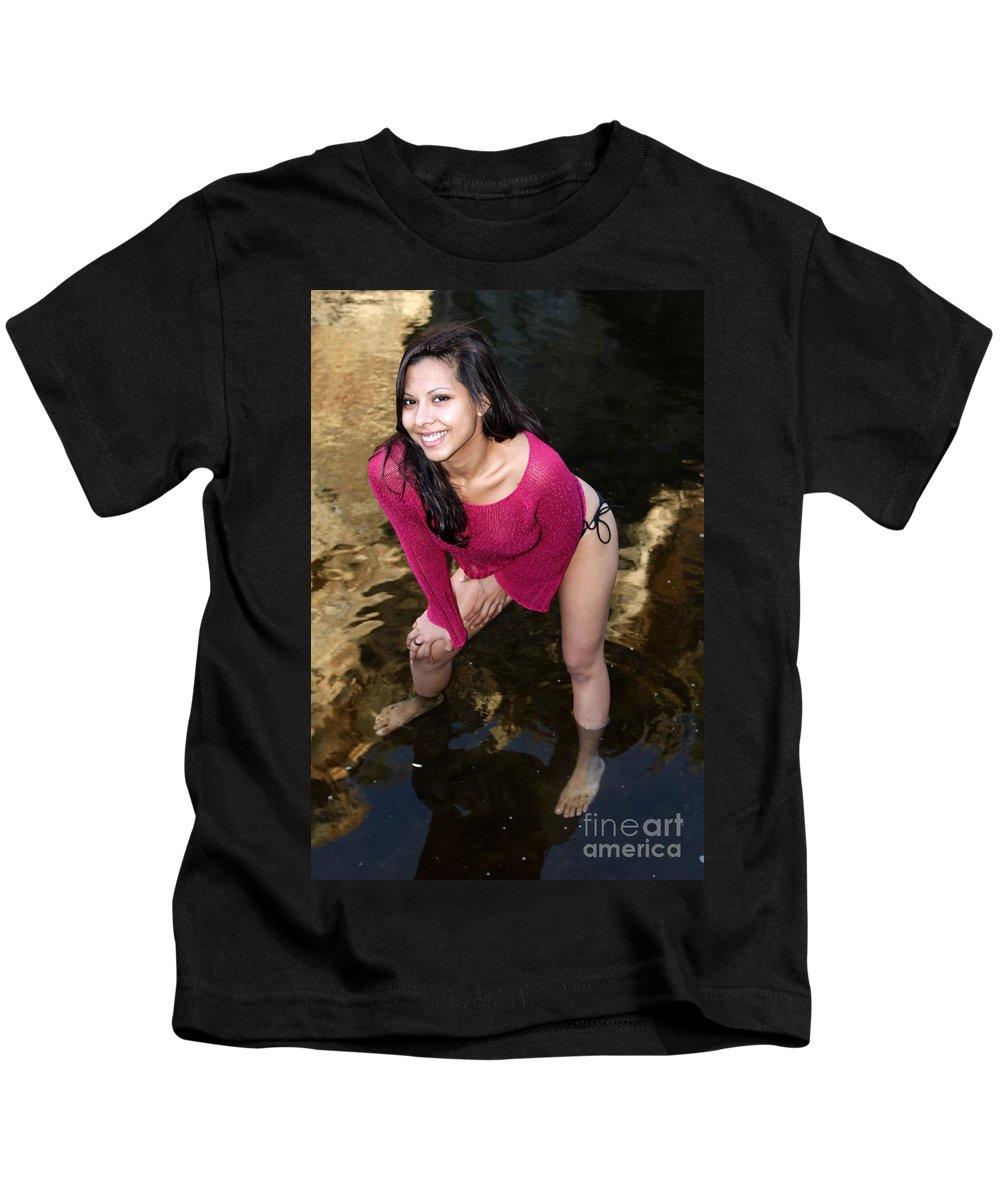 Creek Kids T-Shirt featuring the photograph Young Hispanic Woman In Creek by Henrik Lehnerer