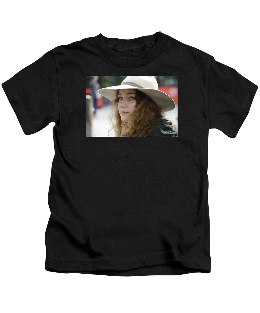 Fine Kids T-Shirt featuring the photograph Young Lady With White Hat 1 by Teo SITCHET-KANDA