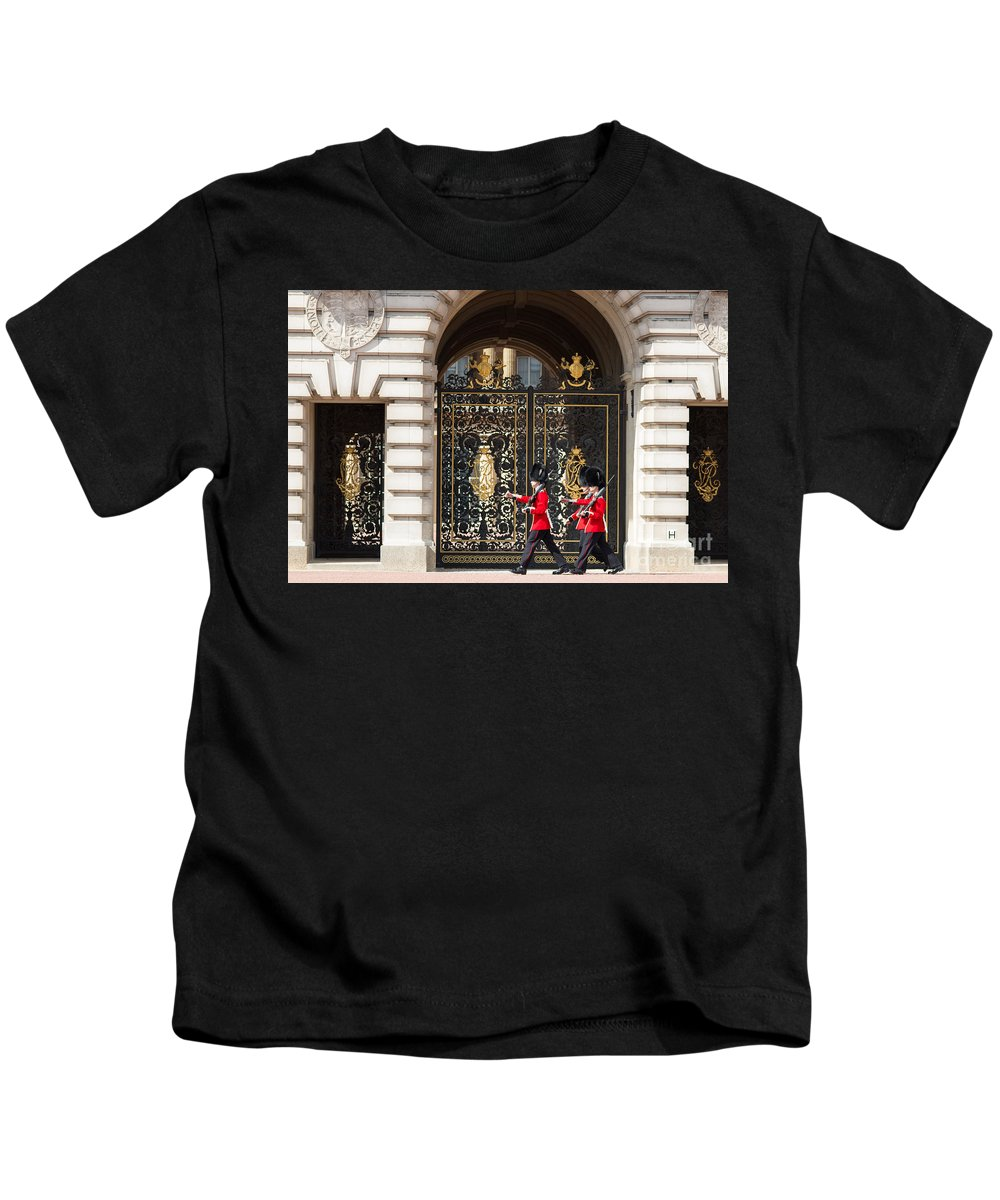British Kids T-Shirt featuring the photograph Buckingham Palace Guards by Andrew Michael