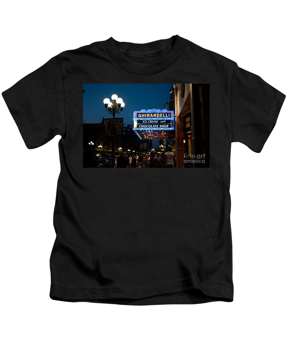 Downtown Kids T-Shirt featuring the digital art Ghirardelli Chocolate Signs At Night by Carol Ailles