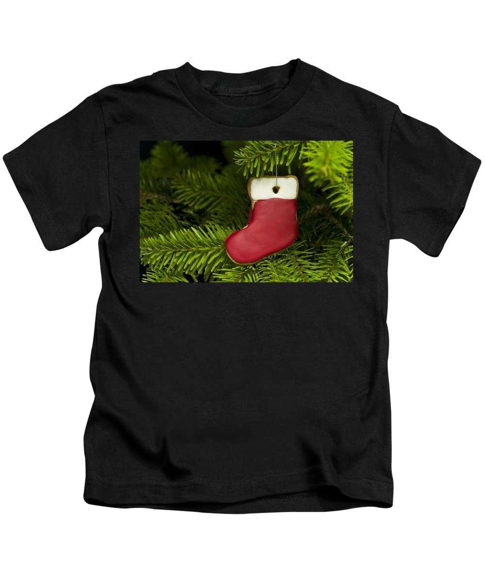 Advent Kids T-Shirt featuring the photograph Present Sock Shape Short Bread Cookie In Christmas Tree by U Schade