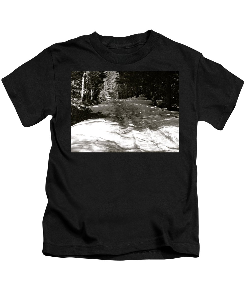 Snow Kids T-Shirt featuring the photograph Snow In April by Linda Hutchins