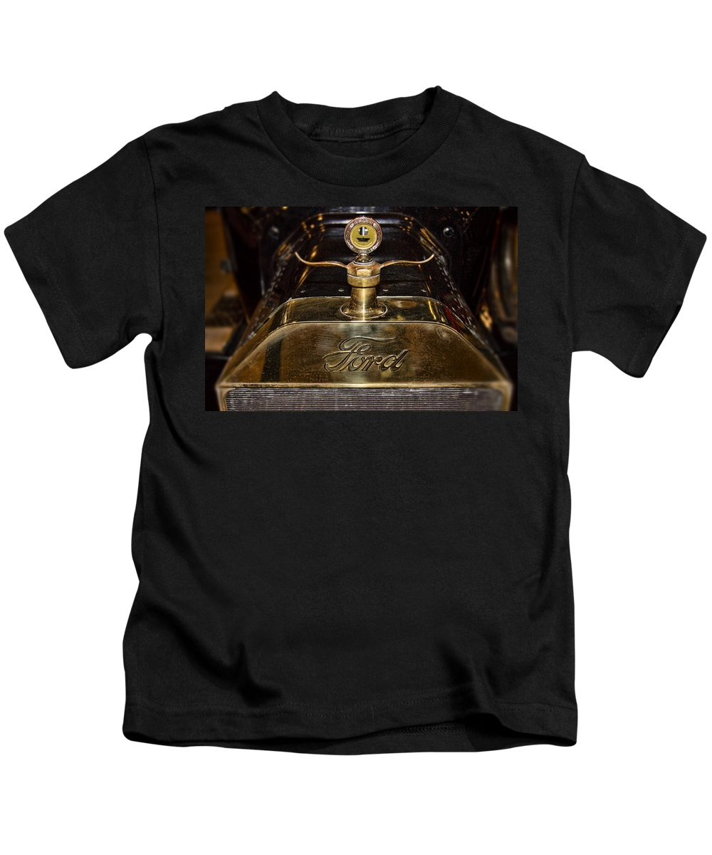 1915 Kids T-Shirt featuring the photograph 1915 Model-t Ford Hood Ornament by Douglas Barnard