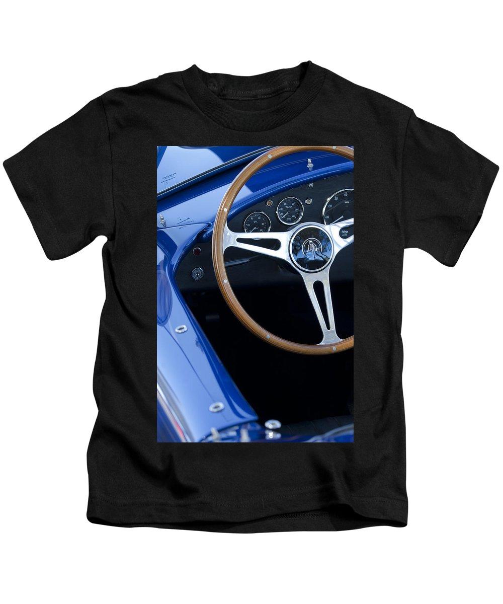 1965 Cobra Sc Kids T-Shirt featuring the photograph 1965 Cobra Sc Steering Wheel 2 by Jill Reger