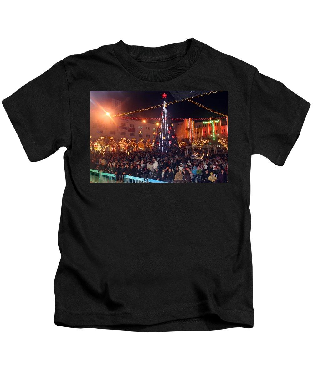 1st Kids T-Shirt featuring the photograph 1st International Christmas Festival by Munir Alawi