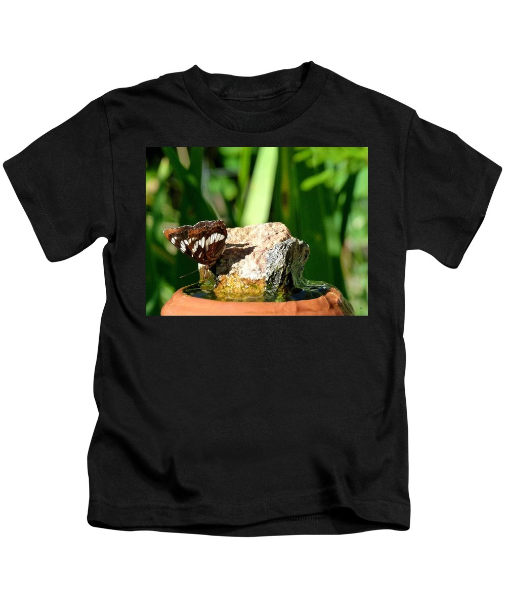 Butterfly Kids T-Shirt featuring the photograph A Butterfly Enjoys A Drink by Will Borden