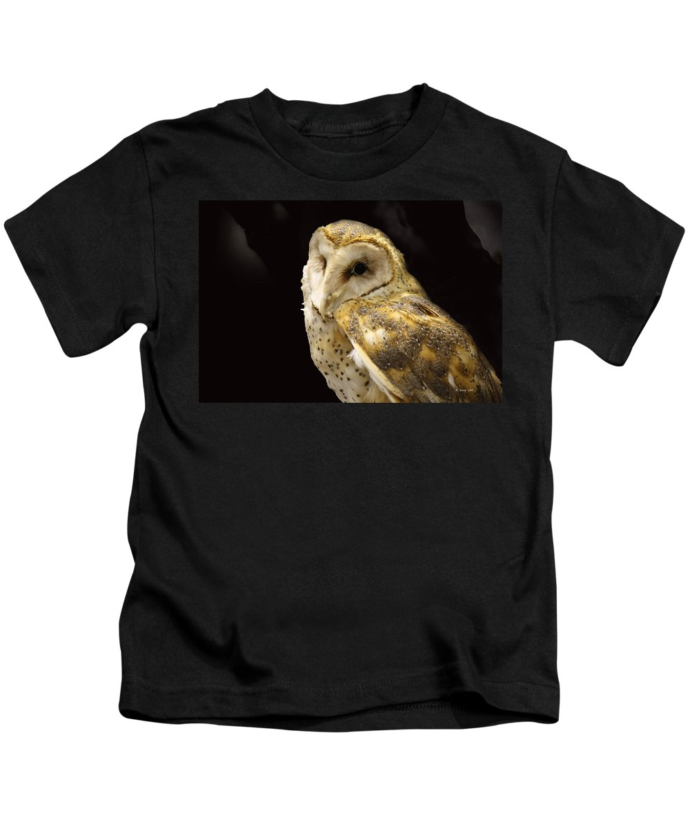 Roena King Kids T-Shirt featuring the photograph Barn Owl In A Dark Tree by Roena King