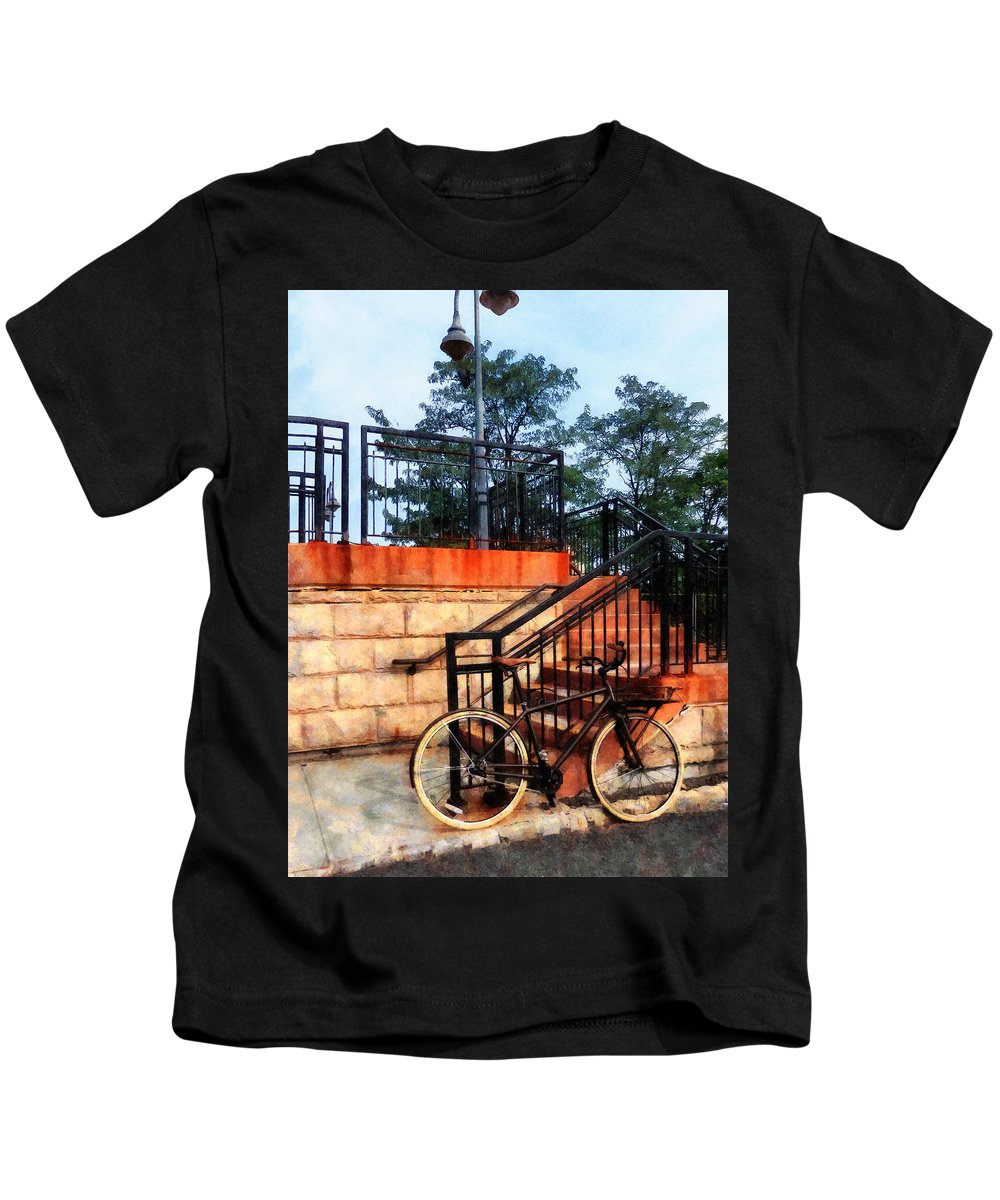 Bicycle Kids T-Shirt featuring the photograph Bicycle By Train Station by Susan Savad