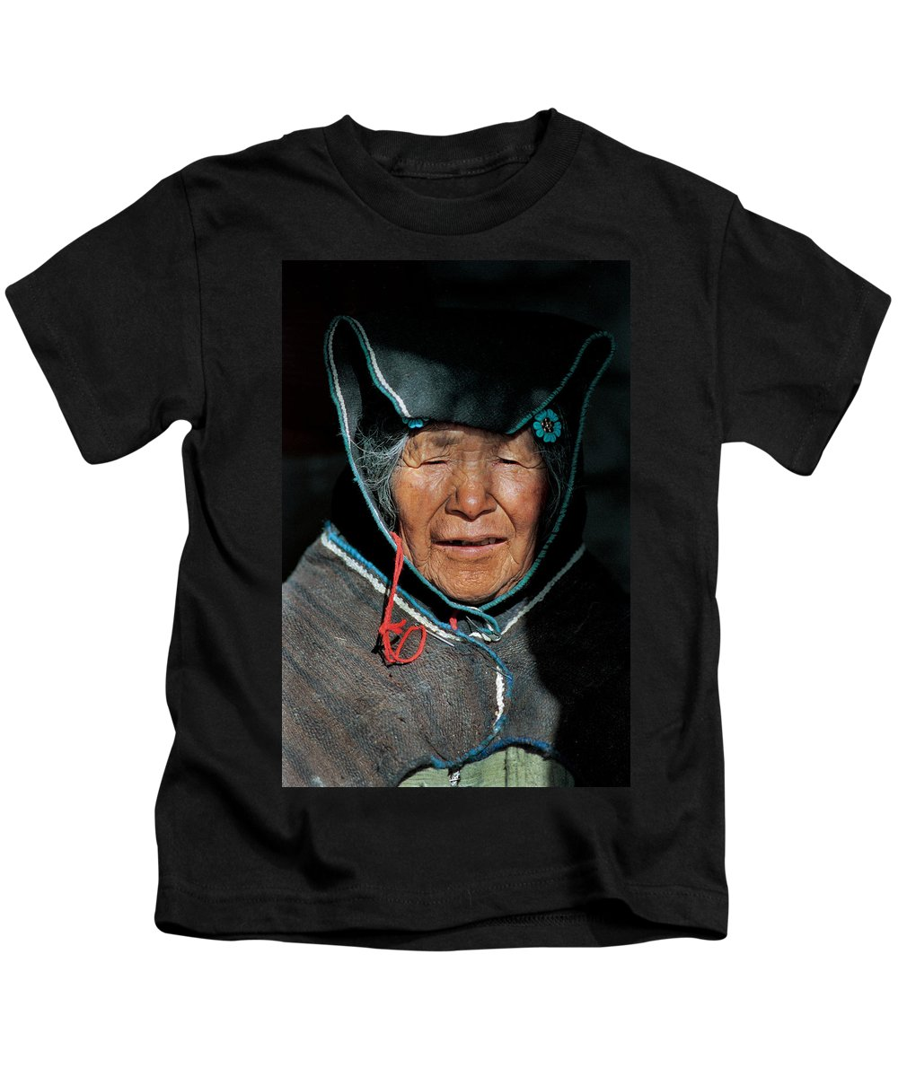 Grandmother Kids T-Shirt featuring the photograph Chipaya Culture Grandmother. Department Of Oruro. Republic Of Bolivia. by Eric Bauer