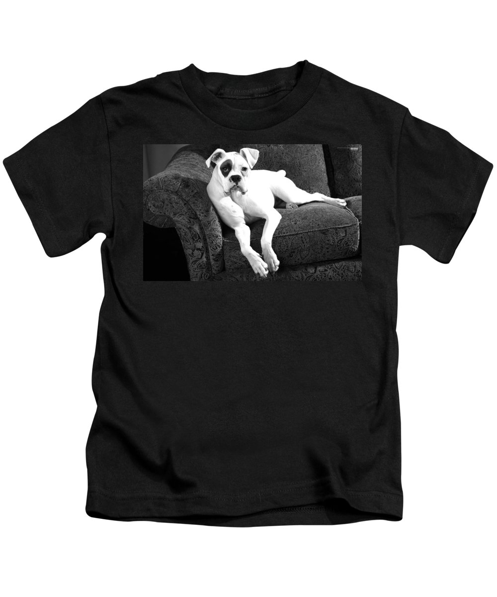 Dog Kids T-Shirt featuring the photograph Dog On Couch by Sumit Mehndiratta