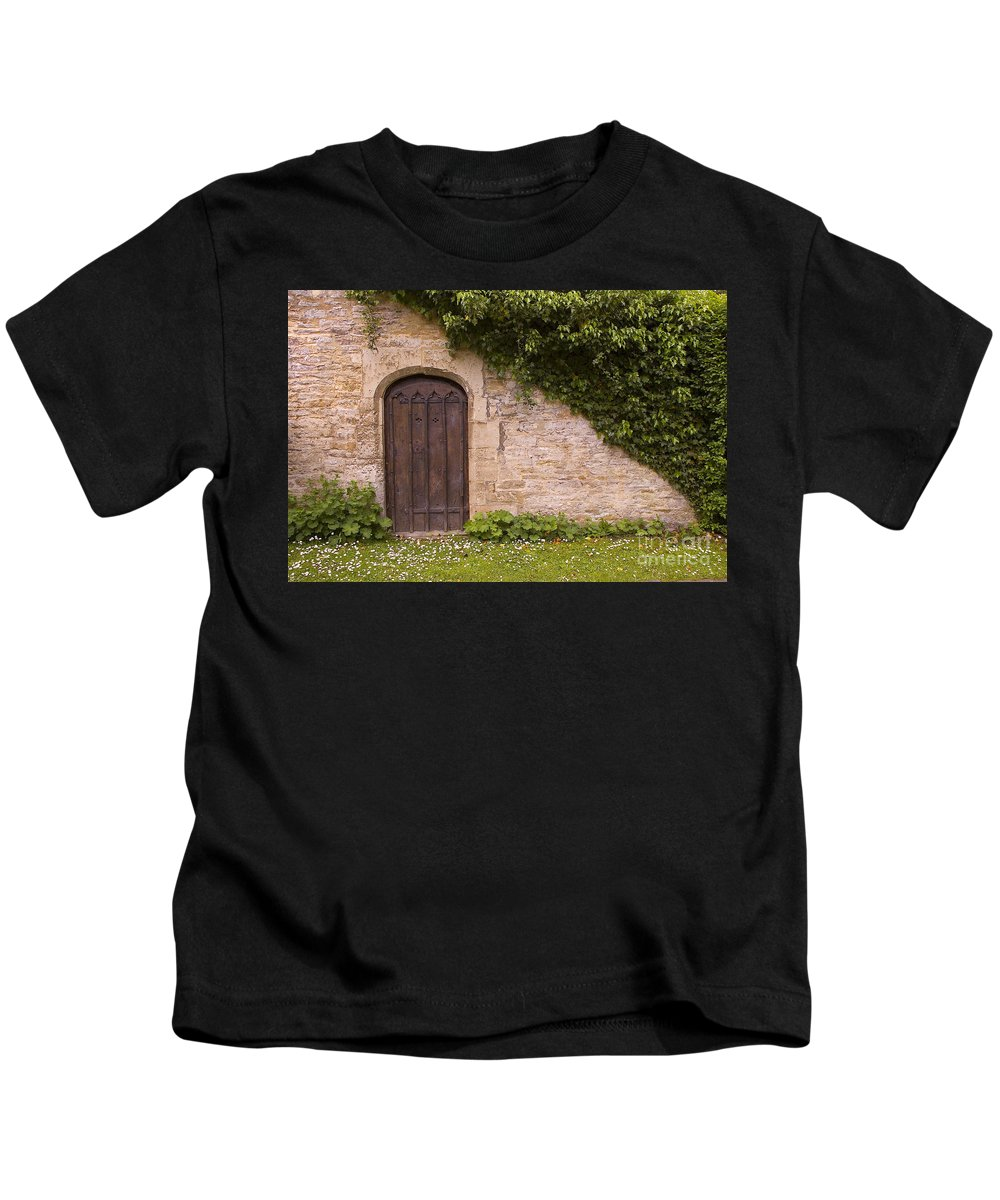 England Kids T-Shirt featuring the photograph English Door And Ivy by Mike Nellums