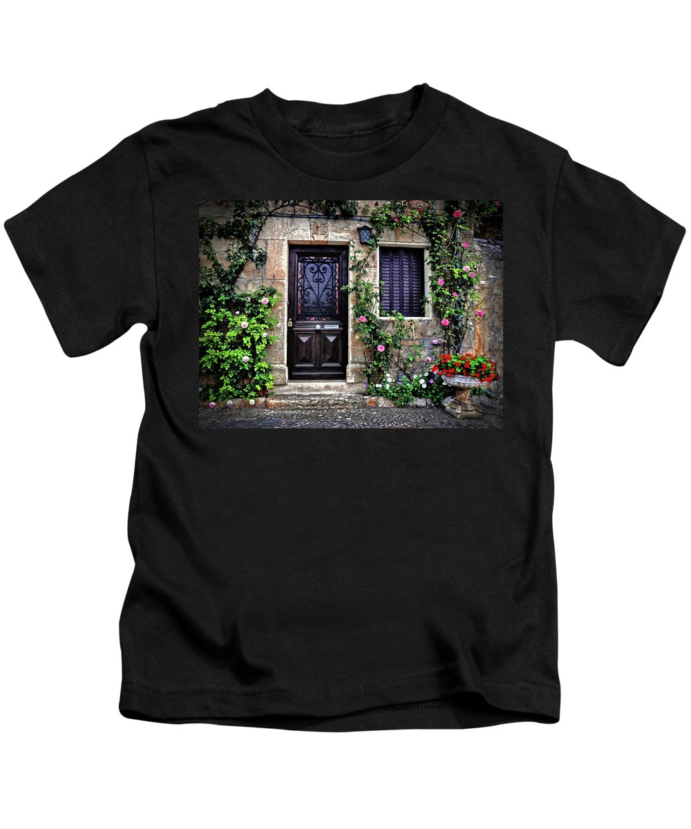 Door Kids T-Shirt featuring the photograph Framed In Flowers Dordogne France by Dave Mills