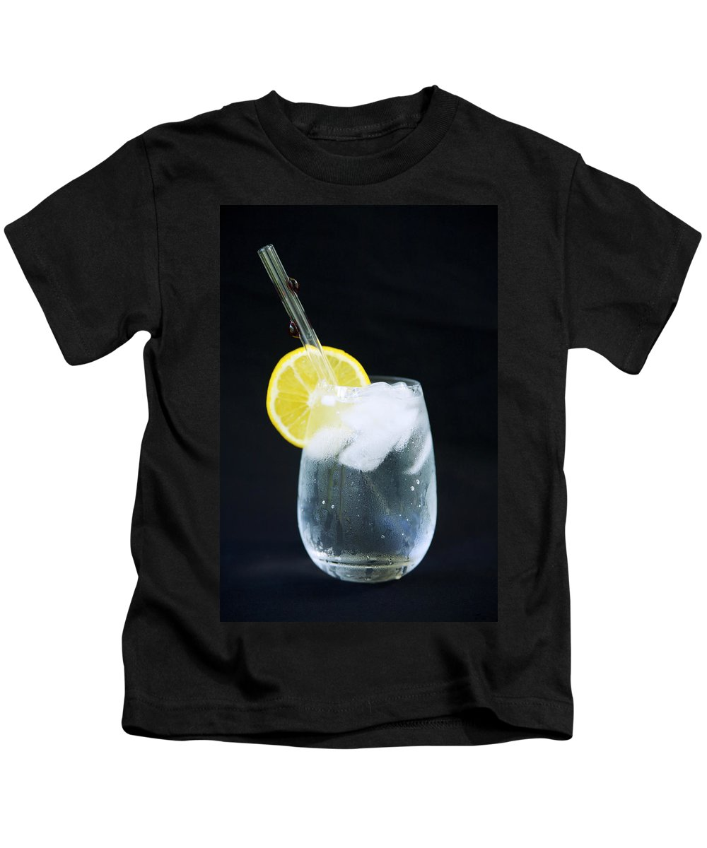 Black Kids T-Shirt featuring the photograph Glass Of Water by Kicka Witte - Printscapes