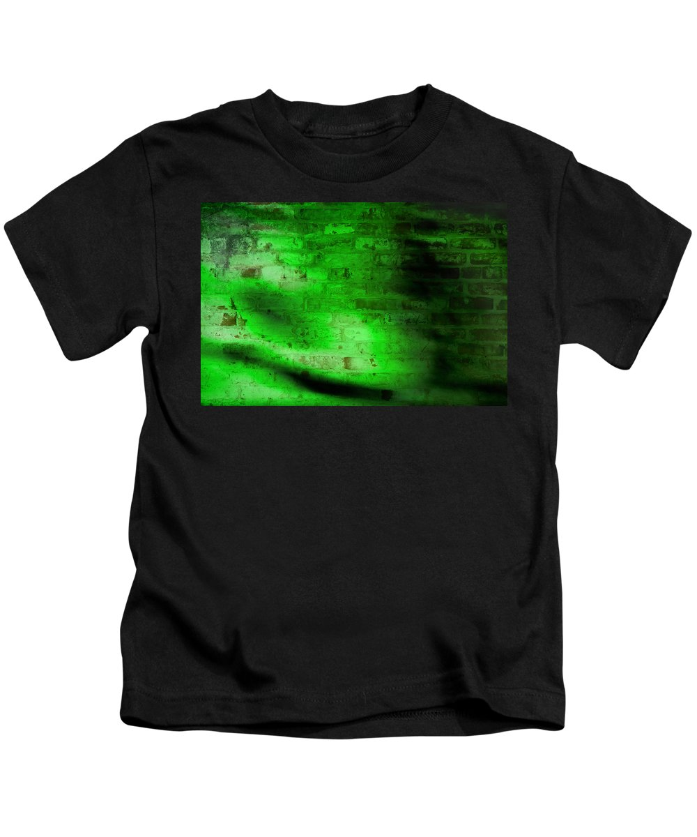 A Grungy Brick Wall With Green Lighting And Shadows. Kids T-Shirt featuring the photograph Green Brick Wall by Susan Leggett