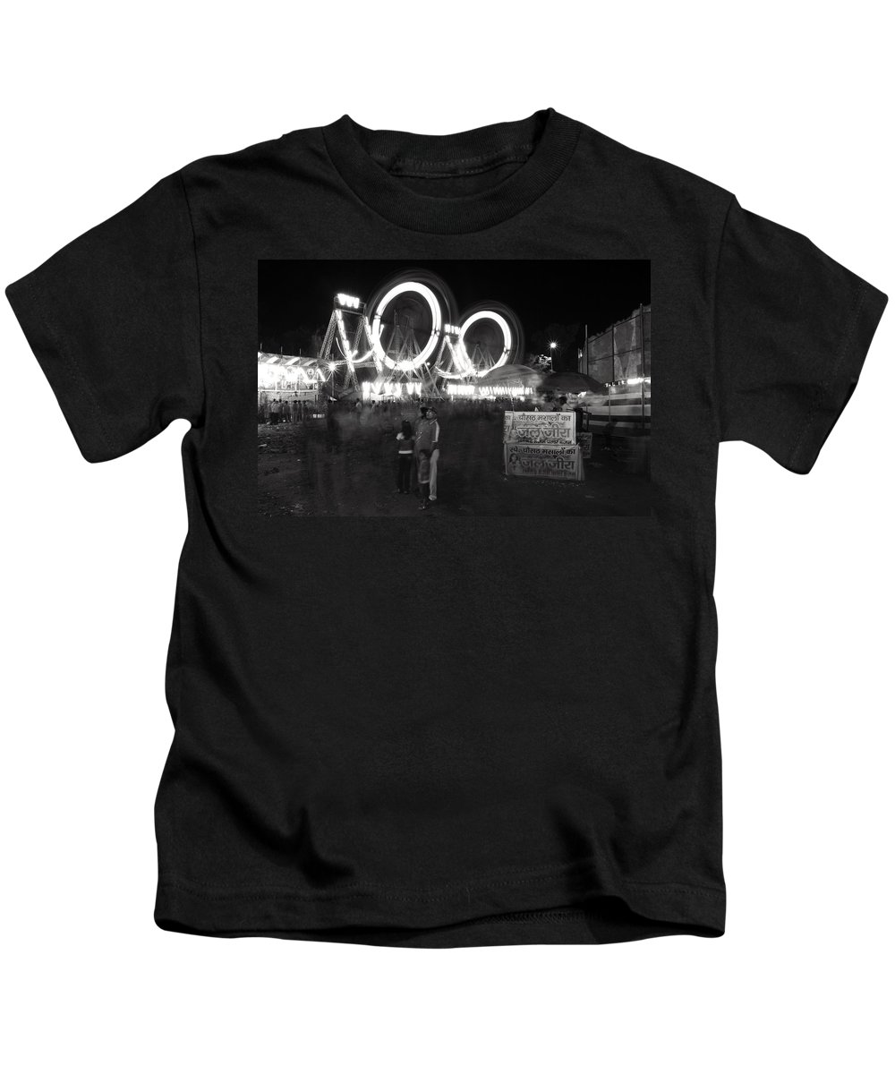 India Kids T-Shirt featuring the photograph Indian Carnival Ferris Wheel And A Family by Sumit Mehndiratta