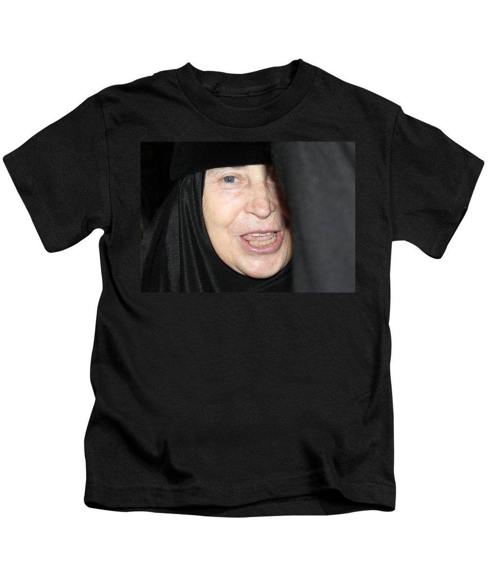 Orthodox Kids T-Shirt featuring the photograph Orthodox Woman At Nativity Church by Munir Alawi