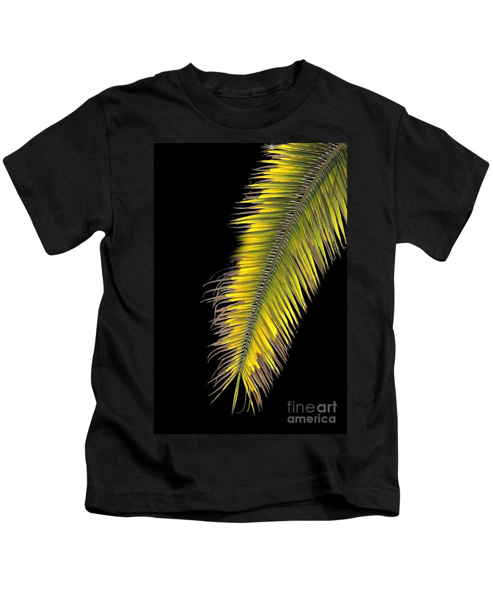 Palm Kids T-Shirt featuring the photograph Palm Frond Against Black by Mike Nellums