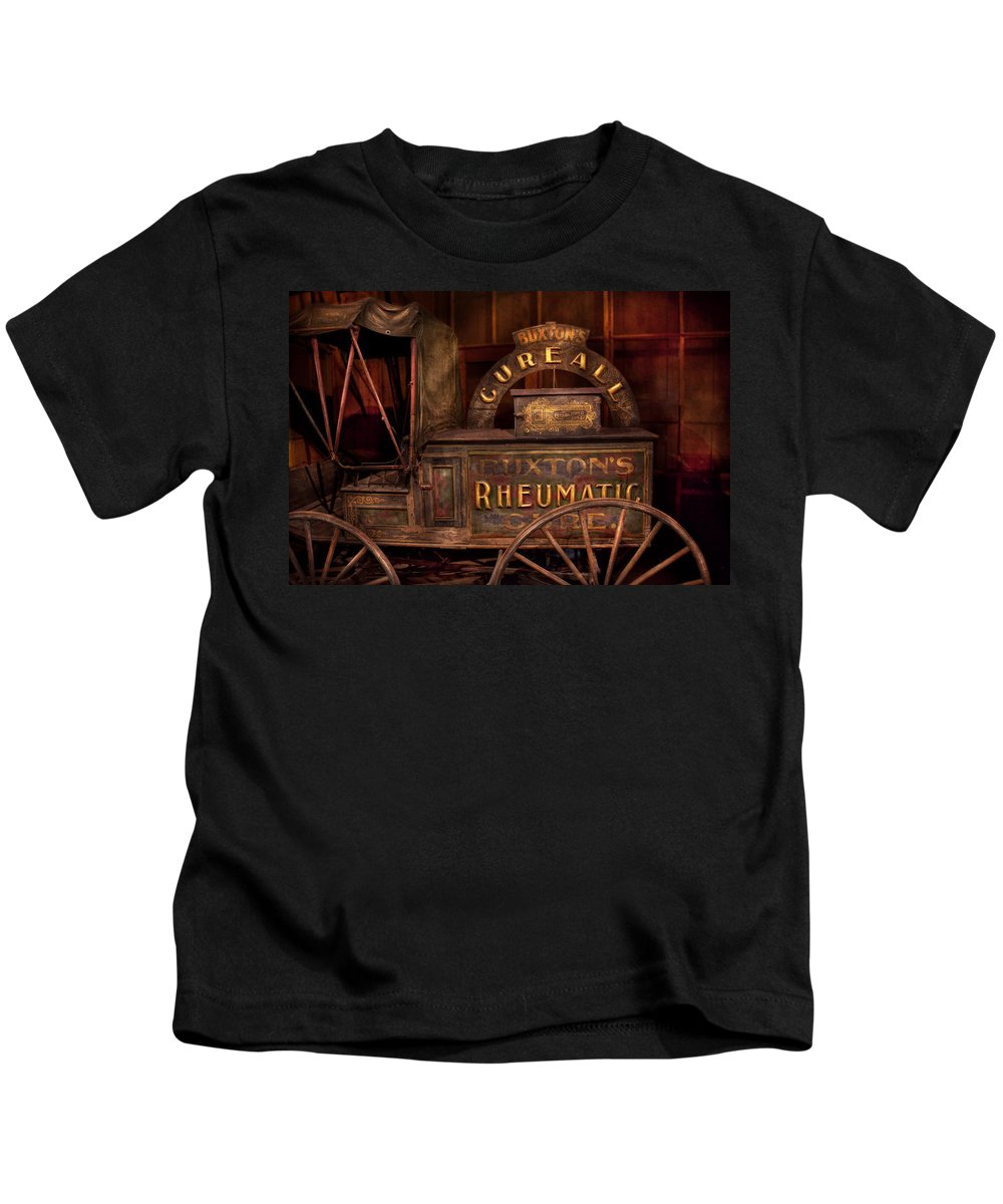 Doctor Kids T-Shirt featuring the photograph Pharmacy - The Rheumatic Cure Wagon by Mike Savad