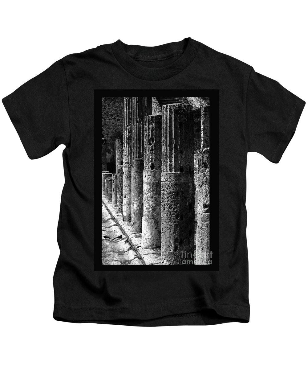 Pompeii Kids T-Shirt featuring the photograph Pompeii Columns Black And White by Mike Nellums