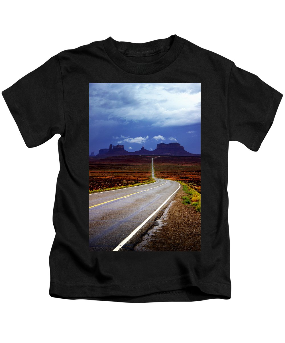 Monument Valley Kids T-Shirt featuring the photograph Rainclouds over Monument Valley by Ellen Heaverlo
