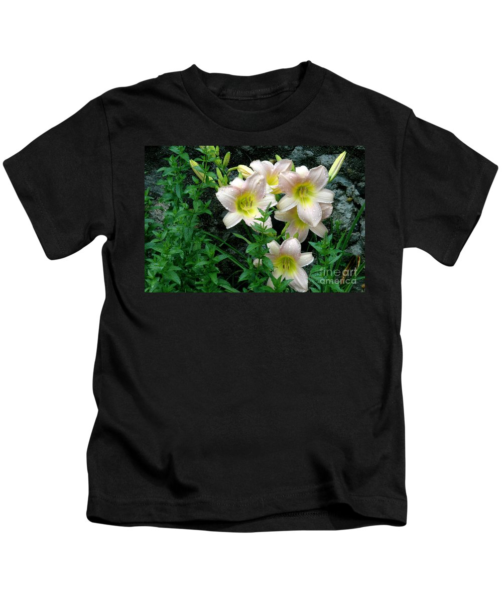 Rain Kids T-Shirt featuring the photograph Rainy Day Day Lilies by Mike Nellums