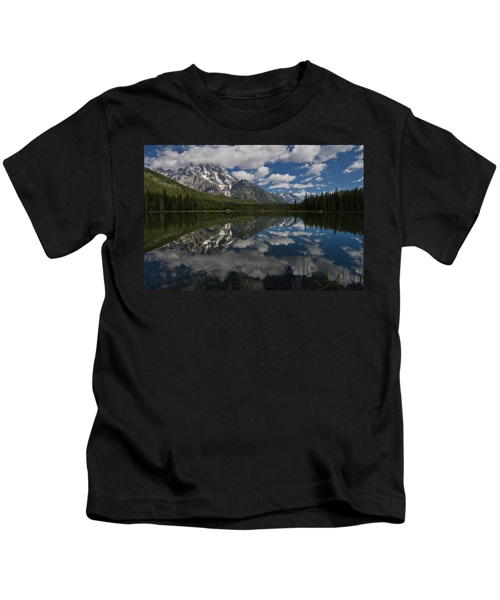 Grand Tetons Kids T-Shirt featuring the photograph Reflections On Mount Moran by Greg Nyquist