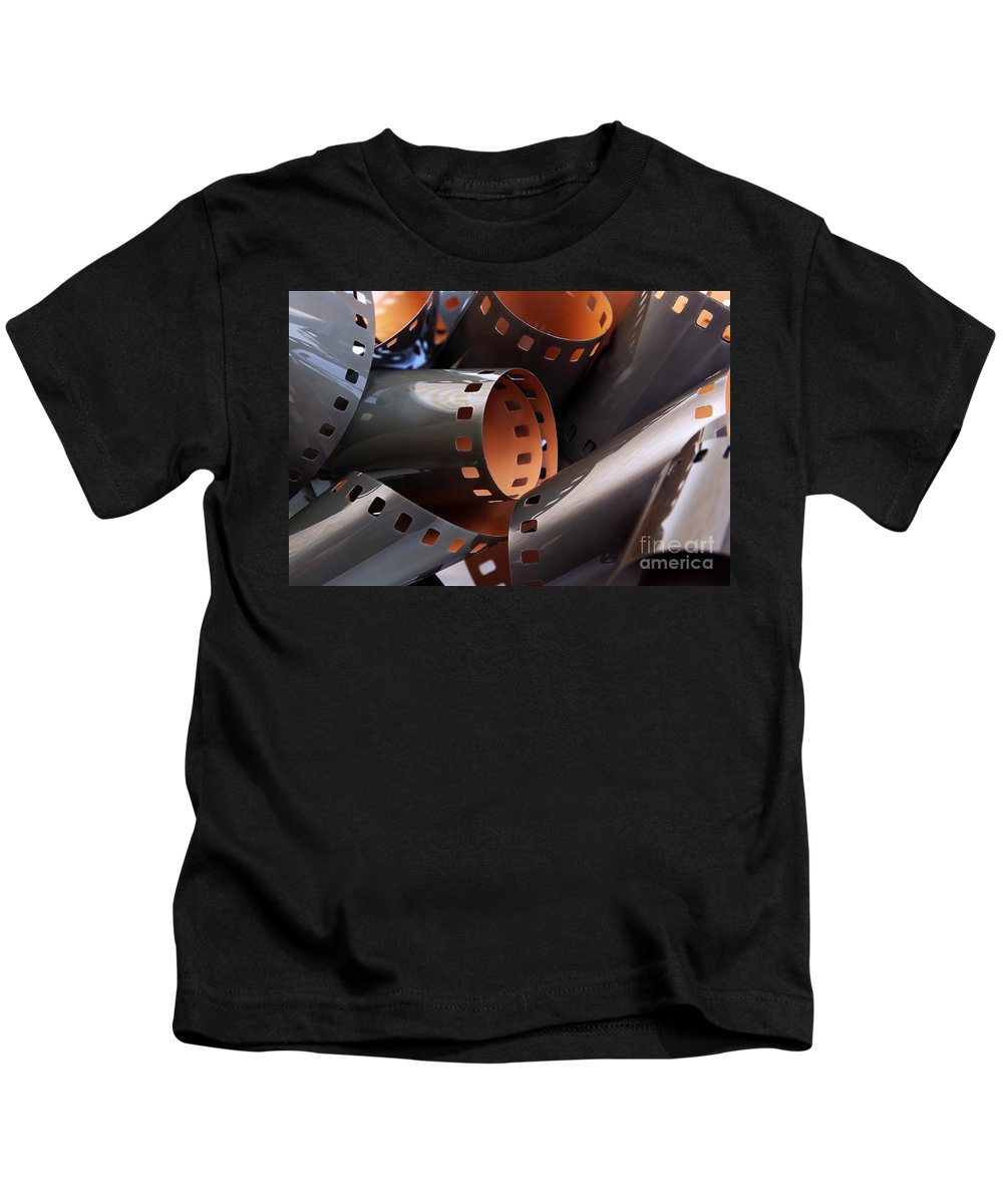 35mm Kids T-Shirt featuring the photograph Roll Of Film by Carlos Caetano