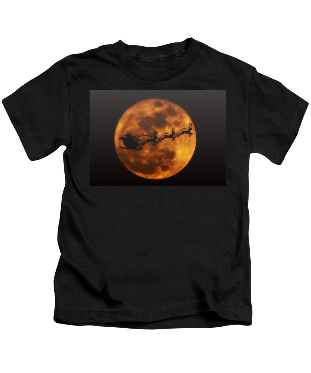 Santa Kids T-Shirt featuring the photograph Santa Across The Sky by Bill Cannon