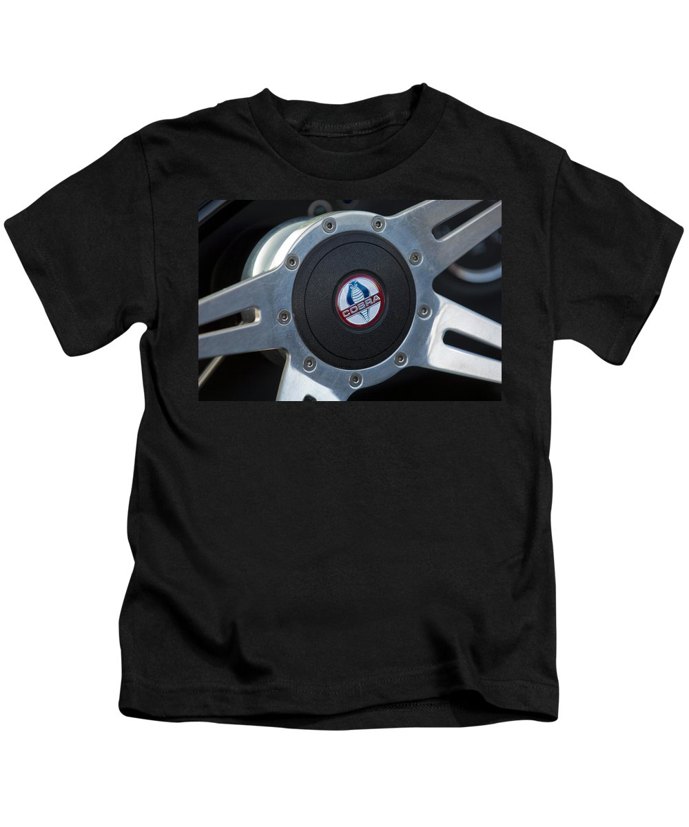 Shelby Cobra Kids T-Shirt featuring the photograph Shelby Cobra Steering Wheel by Jill Reger