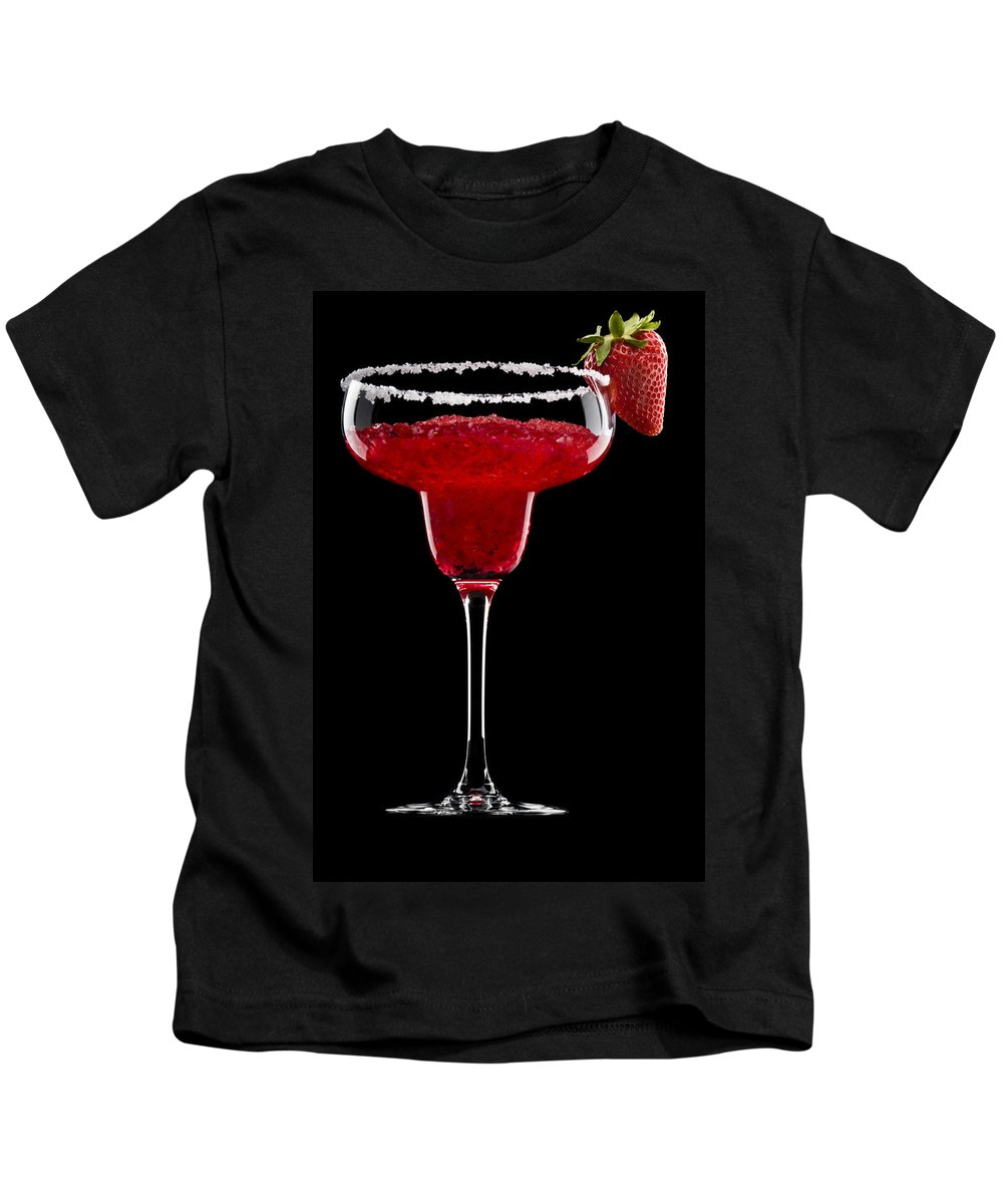 Black Kids T-Shirt featuring the photograph Strawberry Margarita In Front Of A Black Background by U Schade