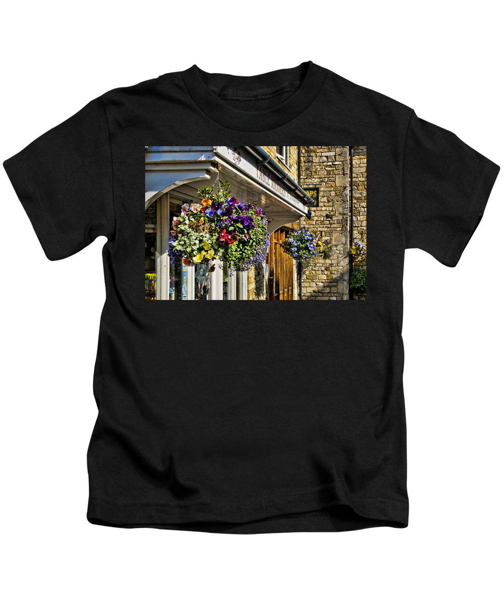 England Kids T-Shirt featuring the photograph Table Manners Store - Broadway England by Jon Berghoff