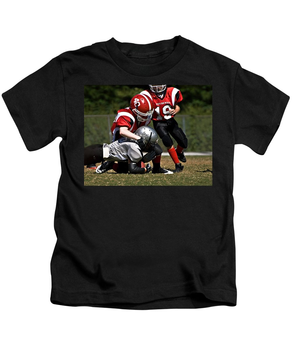 Young Kids T-Shirt featuring the photograph Tackle The Runner by Susan Leggett